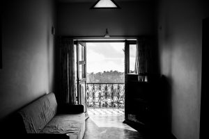greyscale photo of a balcony window in an empty living room