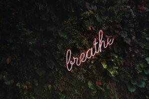 breathe neon lettering for self-care